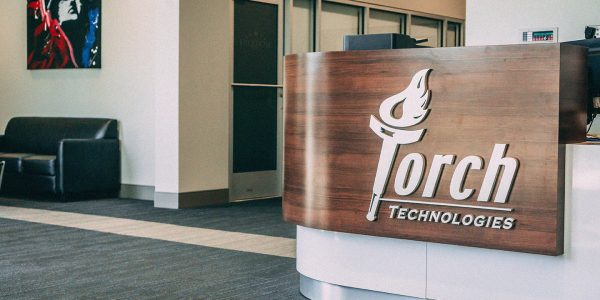 Torch Technologies Environment reception counter with branding