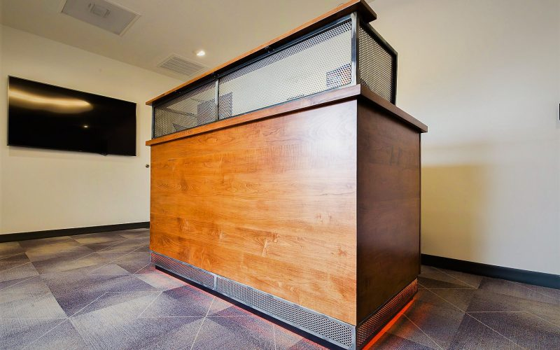 Simple Helix Environment millwork reception counter